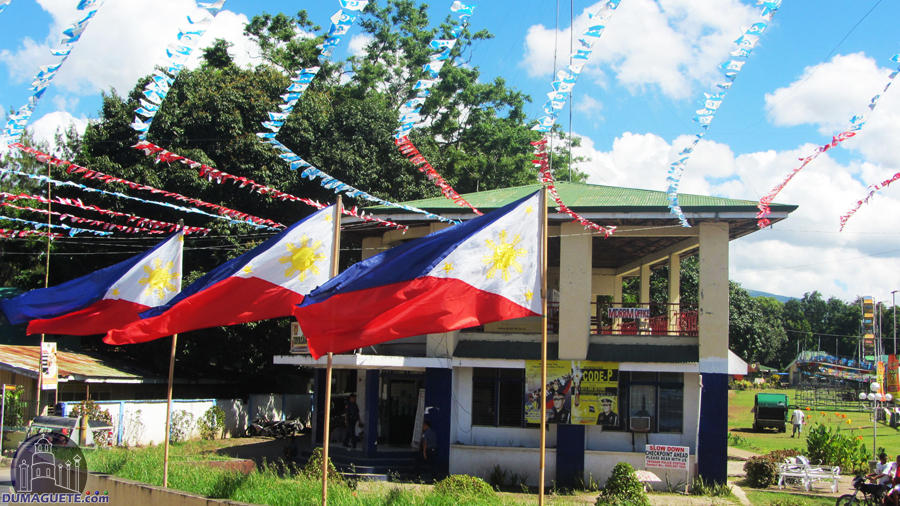 Tayasan Police Station with flags