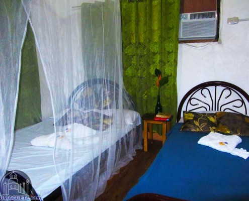 Rooms at JaJAn Beach Resort in Bindoyn-Beach-ResortNipa-hat-roomwith-ari-con
